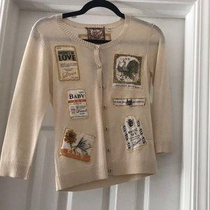 L.A.M.B patch sweater